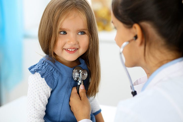 doctor-examining-a-little-girl-by-stethoscope_rogerphoto_adobestock_145299912