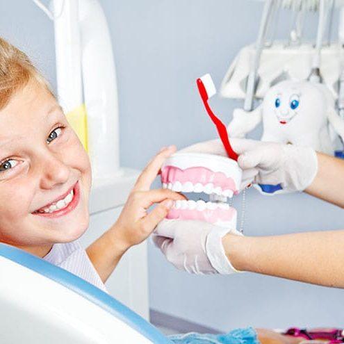 happy-child-with-toy-dentures_2xsamara.com_adobestock_43584110